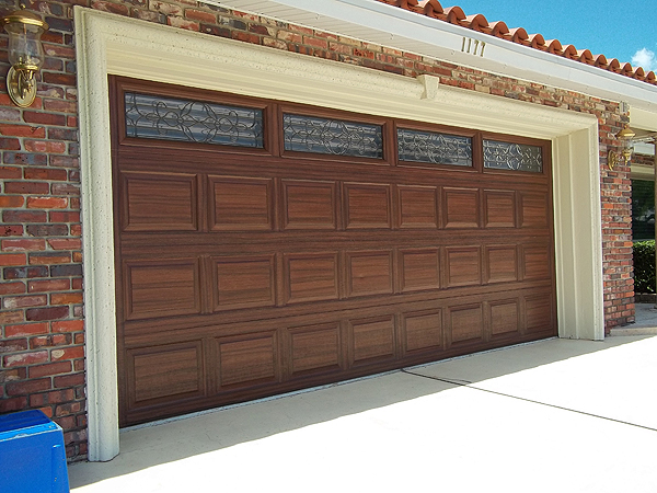 Latest garage door painting project finished everything for Paint garage door to look like wood