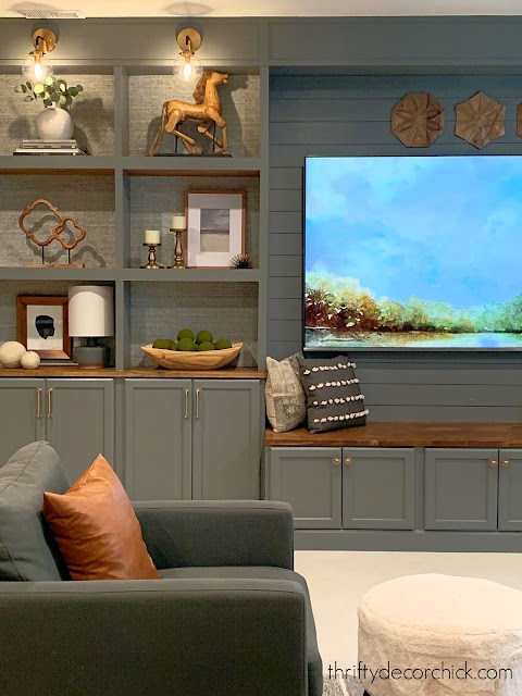 gray built ins with wood bench under TV