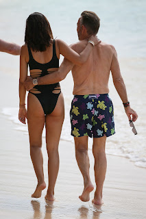Nigora-Bannatyne-in-an-one-piece-black-swimsuit-at-the-beach-in-Barbados.-47idk9a6tw.jpg