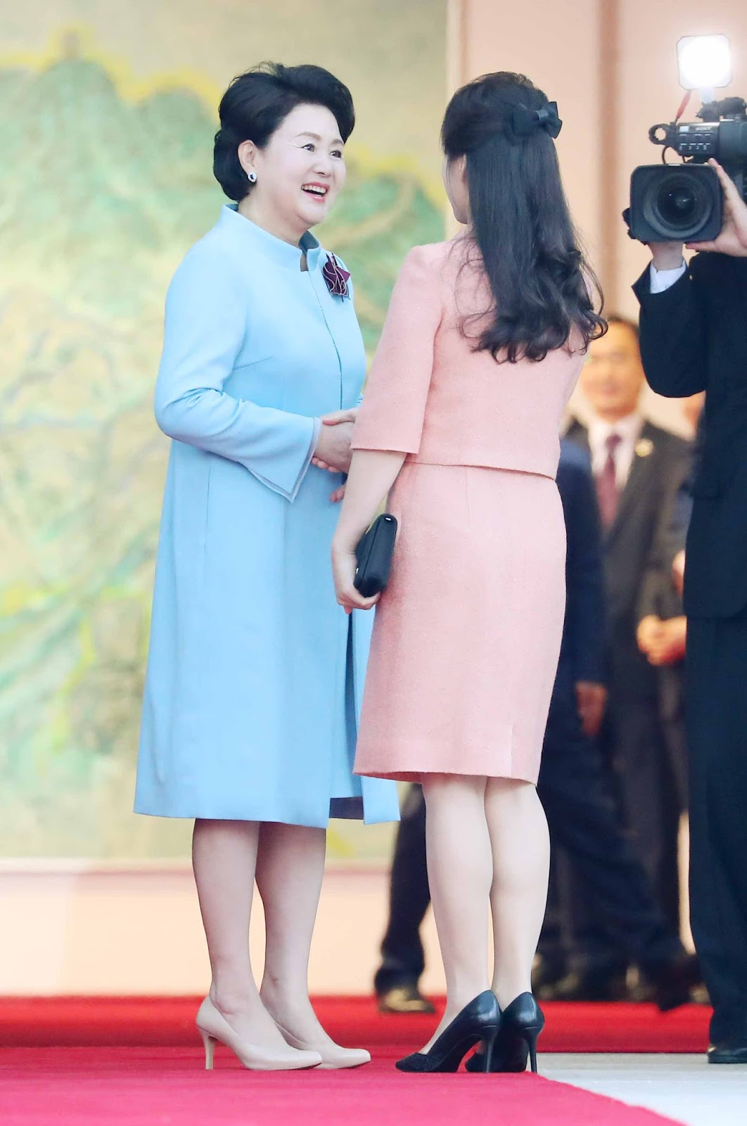 In a historic meeting, Ri Sol-ju, the wife of Kim-Jong Un (right, in the pink dress) and Kim Jung-sook , the wife of President Moon (left, in the blue dress), met, marking the first time the two Korean first ladies had ever come together.