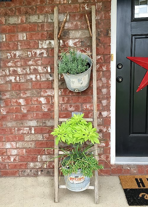 vintage wooden ladder, plant holder, porch decor, galvanized buckets