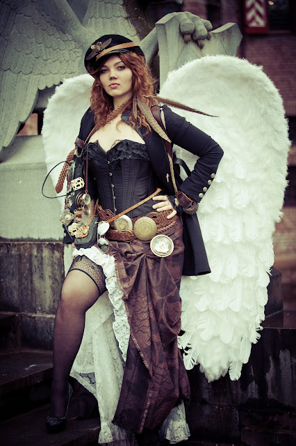Woman dressed in military costume with wings as a steampunk or dieselpunk angel