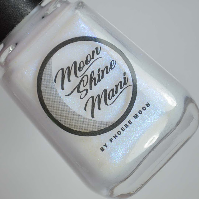 white nail polish with blue shimmer in a bottle