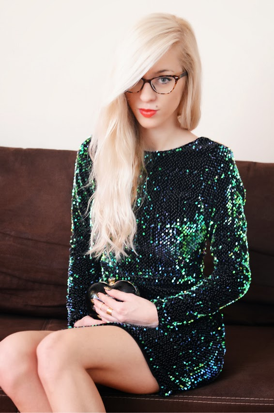 http://www.motelrocks.com/products/MOTEL-DELUXE-Gabby-Sequin-Plunge-Back-Dress-in-Iridescent-Green.html
