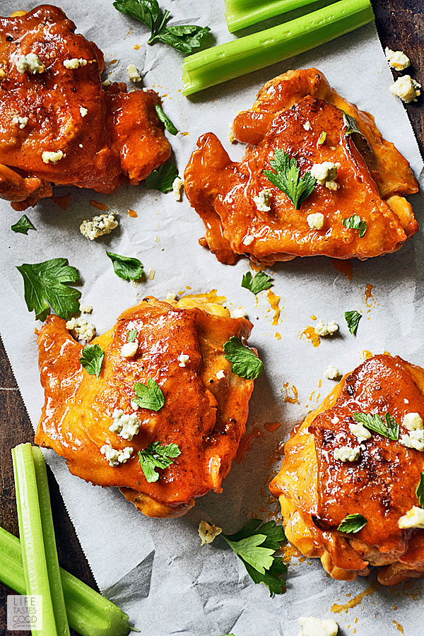 Dripping in a spicy, buttery buffalo wing sauce, Baked Buffalo Chicken Thighs are just as good, if not better, than your favorite buffalo chicken wings. They are low carb, easy to make, and budget-friendly too! #LTGrecipes