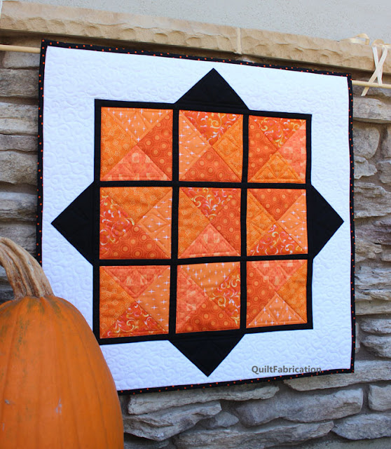 orange, black and white small wall hanging