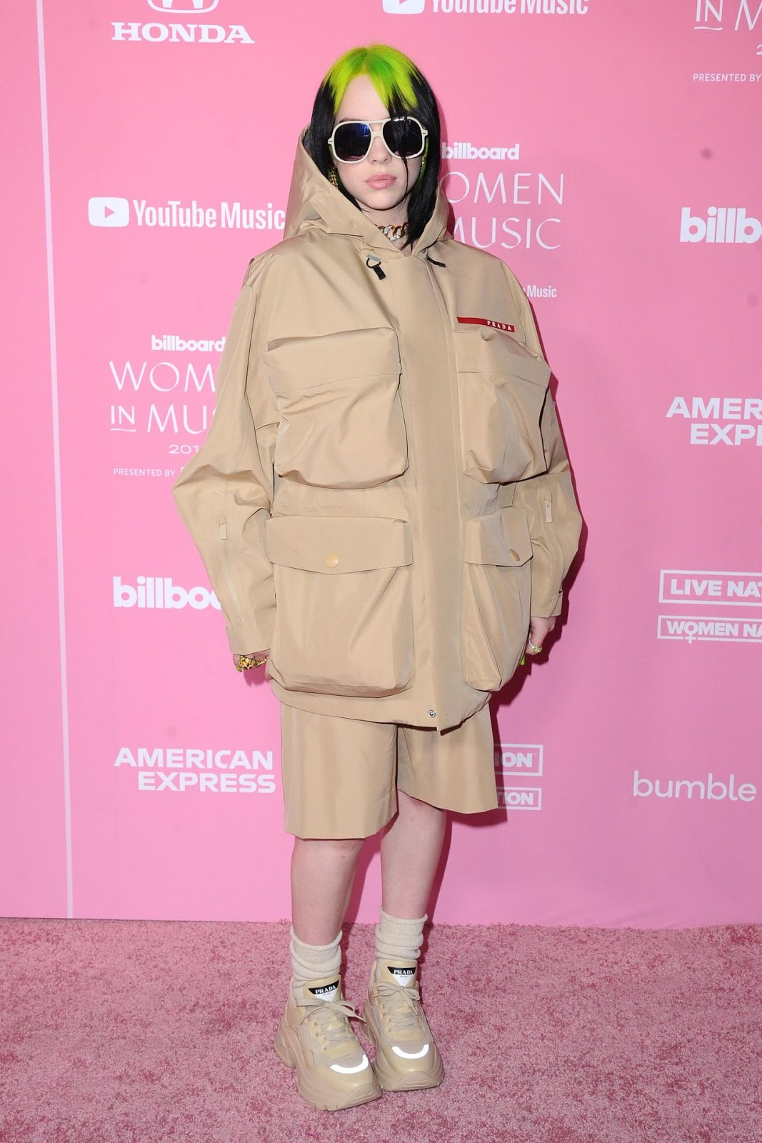 Billie Eilish wears Prada coat with neon hair to the 2019 Billboard Women in Music event in LA