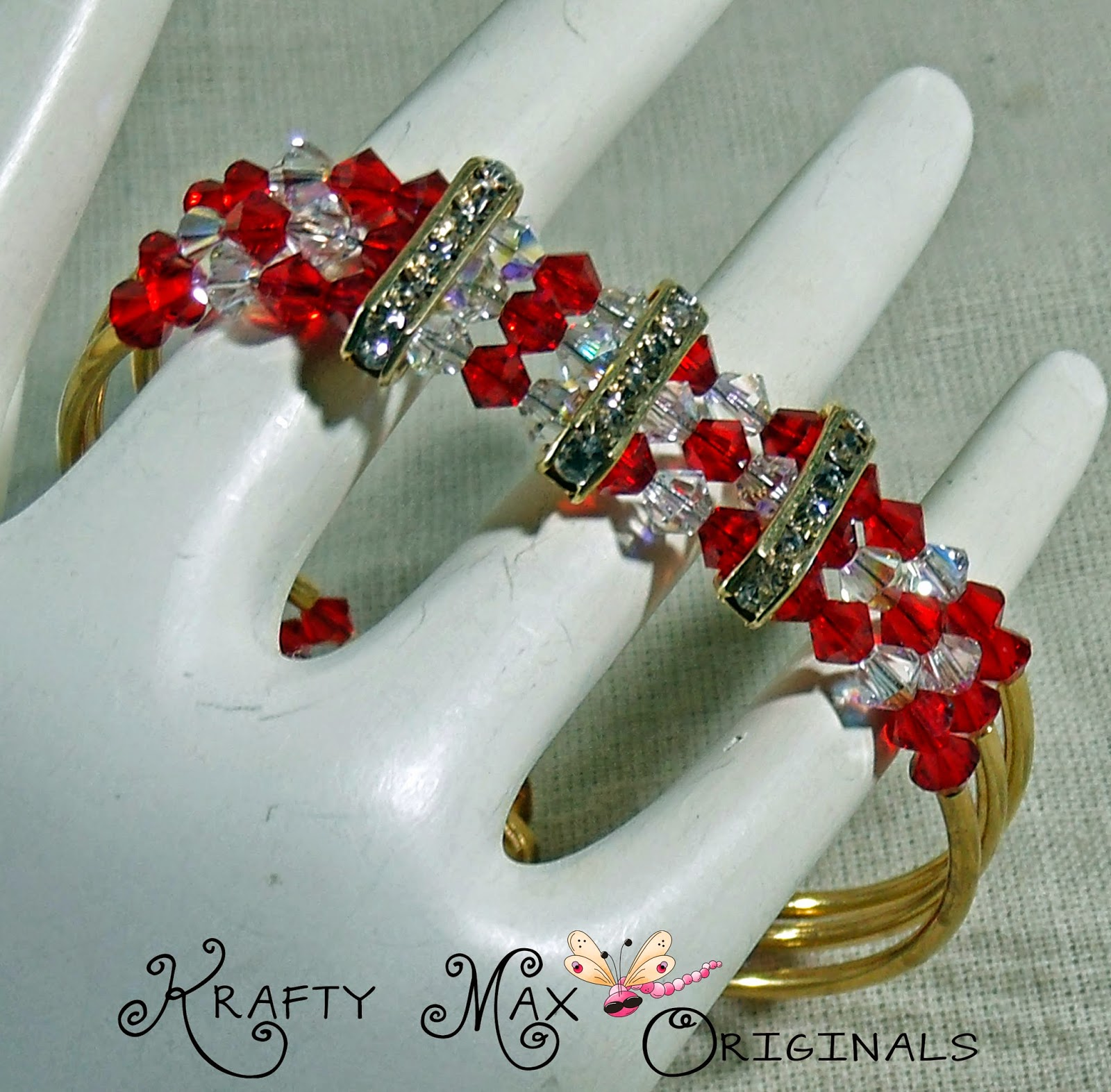 http://www.lajuliet.com/index.php/2013-01-04-15-21-51/ad/beaded,49/exclusive-red-and-clear-swarovski-crystal-and-gold-plated-triple-strand-bracelet-a-krafty-max-original-design,344