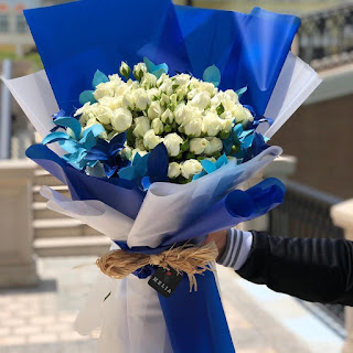 blue wrap bouquet with twine - wedding bouquet ideas - K'Mich Weddings - day-of-service planners in Philadelphia PA