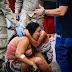 Família acompanha resgate de corpos sob chuva forte na Guaicurus