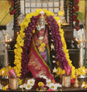 varalakshmi vratam with standing idol