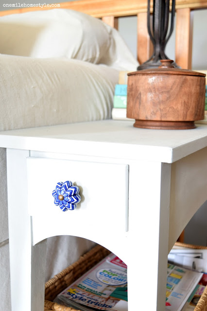 Light grey end table with ornate blue and white knob detail - One Mile Home Style