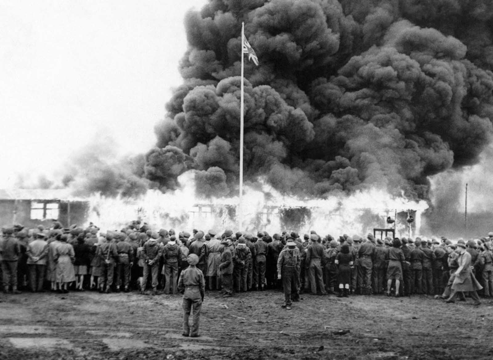 On May 21, Colonel Bird, Commandant of Belsen Camp, gave the order for the last hut at Belsen Concentration Camp to be burned. A rifle salute was fired in honor of the dead, the British flag was run up at the same moment as a flame-thrower set fire to the last hut. A German flag and portrait of Hitler went up in flames inside the hut in June of 1945.