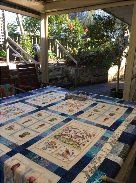 Pinning a quilt on an outside table