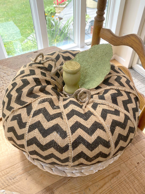 Chevron burlap pumpkin on the table in front of the window