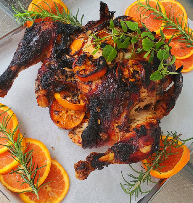 this is an orange whole roasted chicken basted with honey and blood orange juice