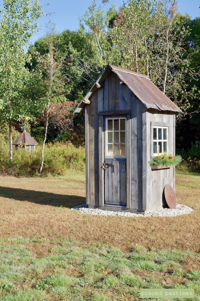 DIY Rustic Outbuilding showing How to Hide an Electric Panel at Pieced Pastimes