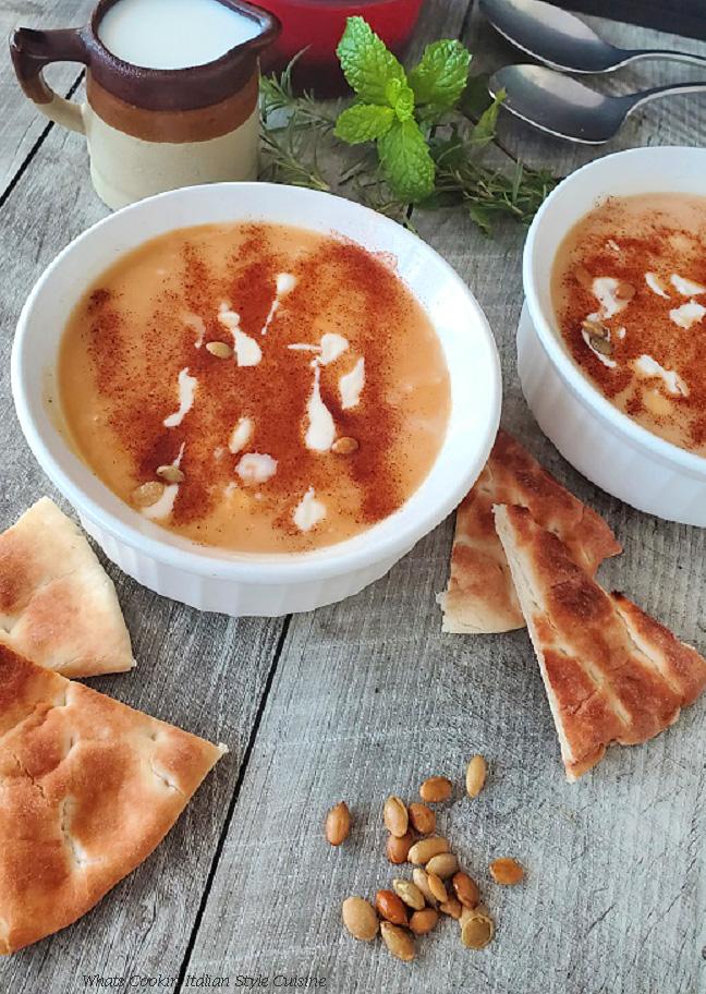 butternut soup with heavy cream, pumpkin seeds drizzled with heavy cream and sprinkled with nutmeg