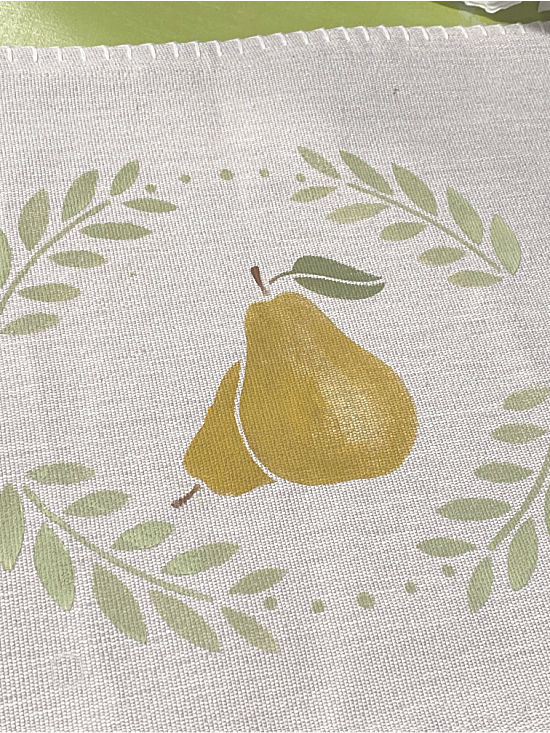 pear stenciled on a pillow