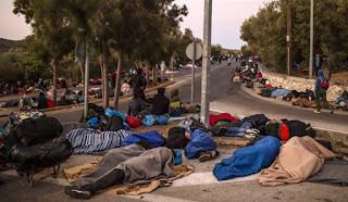 Moria fire leads thousands of refugees to sleep on rough ground the Greek island of Lesbos