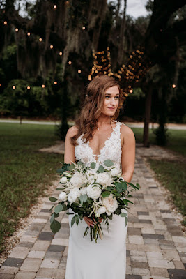 bride with big bouquet at ever after farms florida