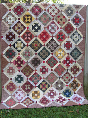Churndash quilt of thrift store plaid shirts