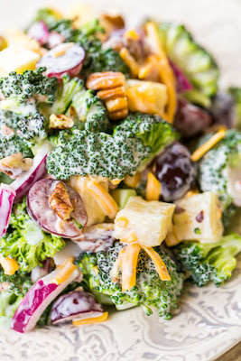 Broccoli Pineapple Salad - so simple and SOOO good!! Seriously delicious!! Fresh broccoli, cheddar cheese, red onion, red grapes, fresh pineapple, pecans, bacon, mayonnaise, cider vinegar and sugar. Great for spring/summer cookouts, potlucks, camping and Easter side dish! We ate this for lunch and dinner the same day. Can make ahead and refrigerate for several days. Such a quick and easy fruit and vegetable side dish recipe!