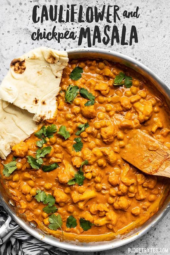 This super easy, ultra creamy, and heavily spiced Cauliflower and Chickpea Masala will be your new favorite weeknight dinner! So much flavor, so little effort