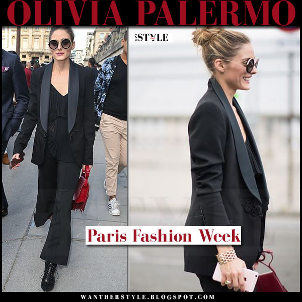 Olivia Palermo in black tuxedo jacket elie saab, black tibi pants red fringed bag black Givenchy booties what she wore paris fashion week