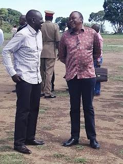 President Kenyatta shared a joke with his deputy in Nyamira, Kisii. PHOTO | Courtesy PSCU