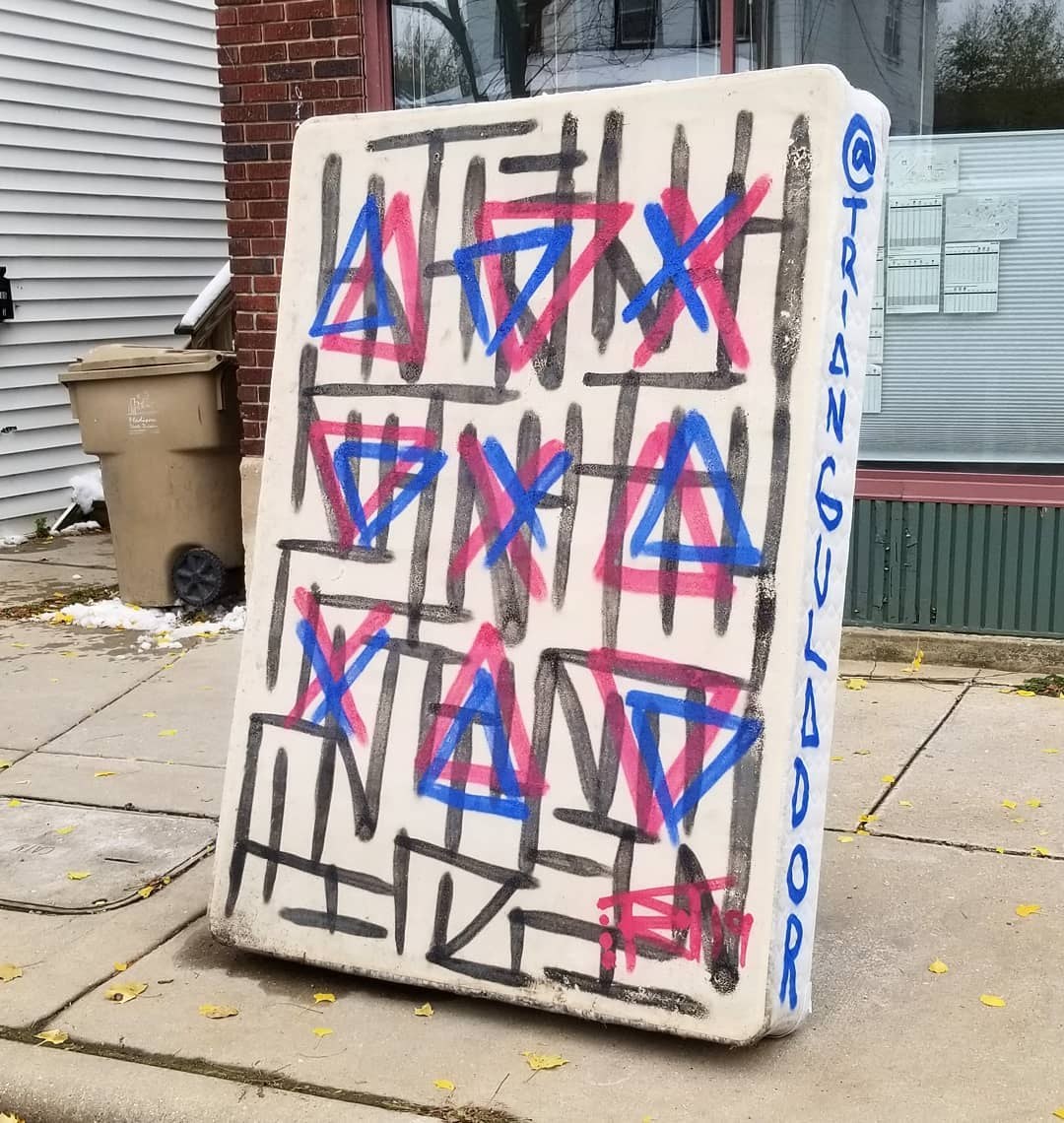 Image contains street art outdoors sidewalk on mattress