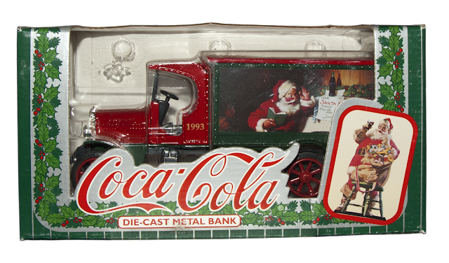 A Coca-Cola collectible truck issued in 1993 for the Christmas Season with a Christmas tableaux on the side.