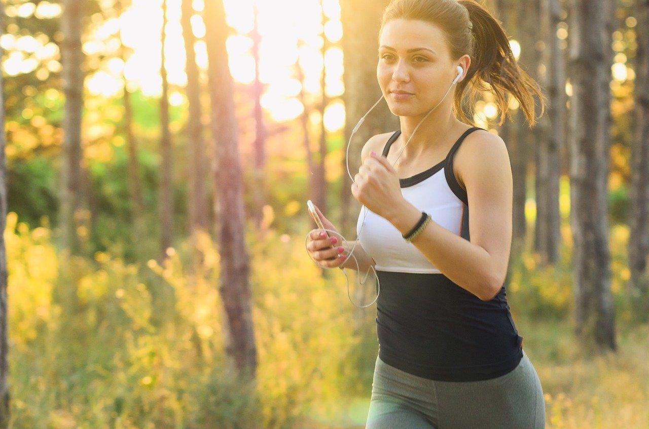 A woman running through a green space