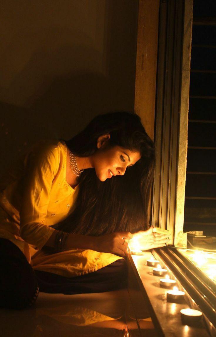 diwali poses with diya