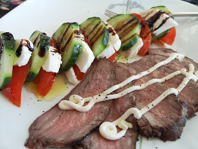 A nice salad with cucumber, fresh Mozza and tomatoes  with leftover roast beef