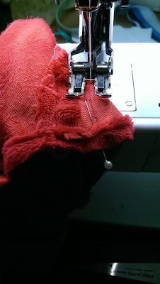 Sewing the bear's snout