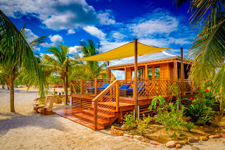 Luxury beach cabanas on Harvey Caye, Belize, Norwegian Cruise Line Holdings