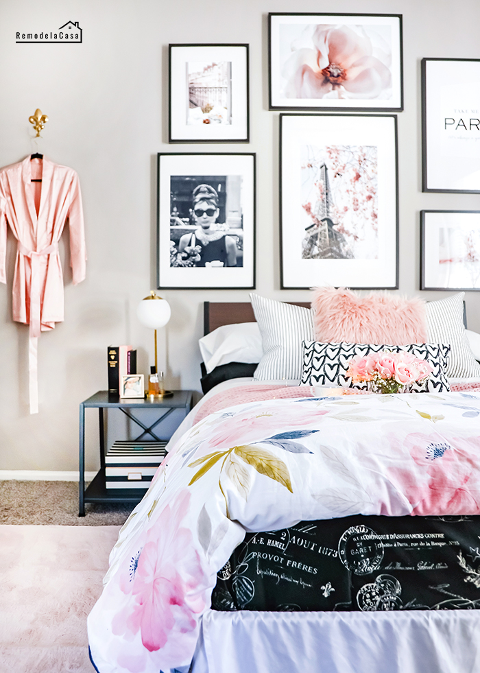 comfy bed with Parisian comforter and floral duvet cover