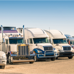 Trucks lined up for trucking dispatch using truck driver dispatcher