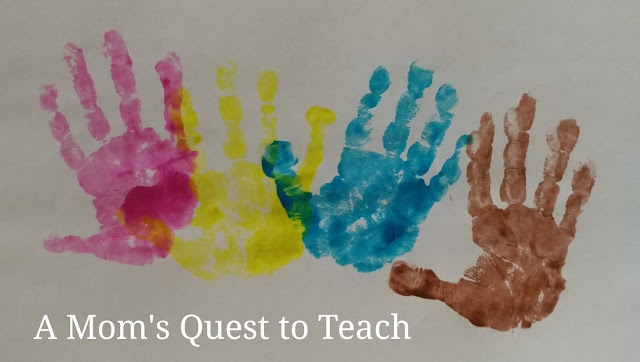 four handprints in different colors
