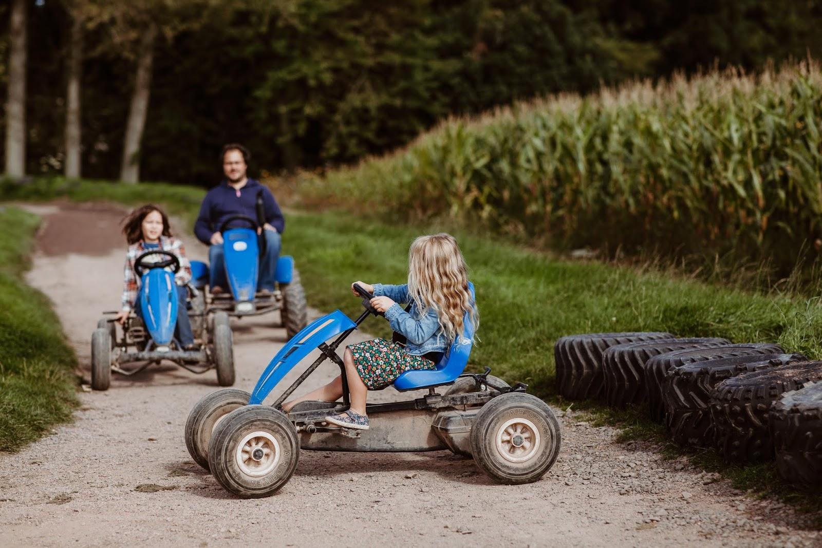 children riding go karts