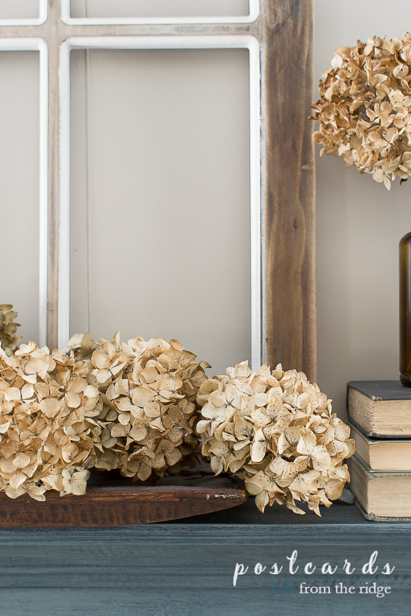 dried hydrangeas on fireplace mantel