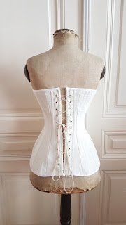 back view of the edwardian corset on an edwardian dress form