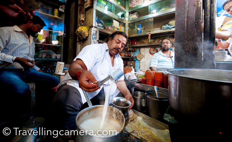 Recently I was out with blogger friends for #TeaTrails experience by Le Meridien  and we hit this 70+ years old tea shop in Old Delhi. This shop is located in Chandni Chowk, on the main road which is just opposite to Red Fort. Still this shop is serving hundreds of tea lovers in Delhi. This Photo Journey shares more about the tea they serve and folks behind this.When we talk about favorite food options in Delhi, Old delhi comes to the mind and I am sure that you must have heard about Paranthe wali gali, Nataraj ke Bhalle, desi ghi vali jalebi etc. But if you are in Chandni Chowk, also make a point to visit Kailash Chandra Jain tea shop. This family in into tea business for more than 70 years now. Apart from tea, they also sell rabri. This shop is also popular for 'Chalu chai',which is essentially a masala tea.This tea is offered in kulhad for 20 rs. Milky with the flavor of  cardamom and topped with almonds & saffron. And they serve fresh made mathi with chai. Tea with almonds doesn't really sound interesting, but when you sip it you are love it. So whenever around Old Delhi, move to Jain tea shop for a kulhad of tea