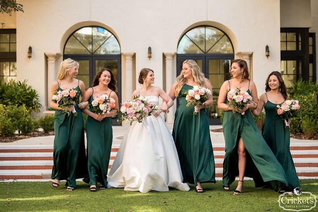bride with bridesmaids in emerald green