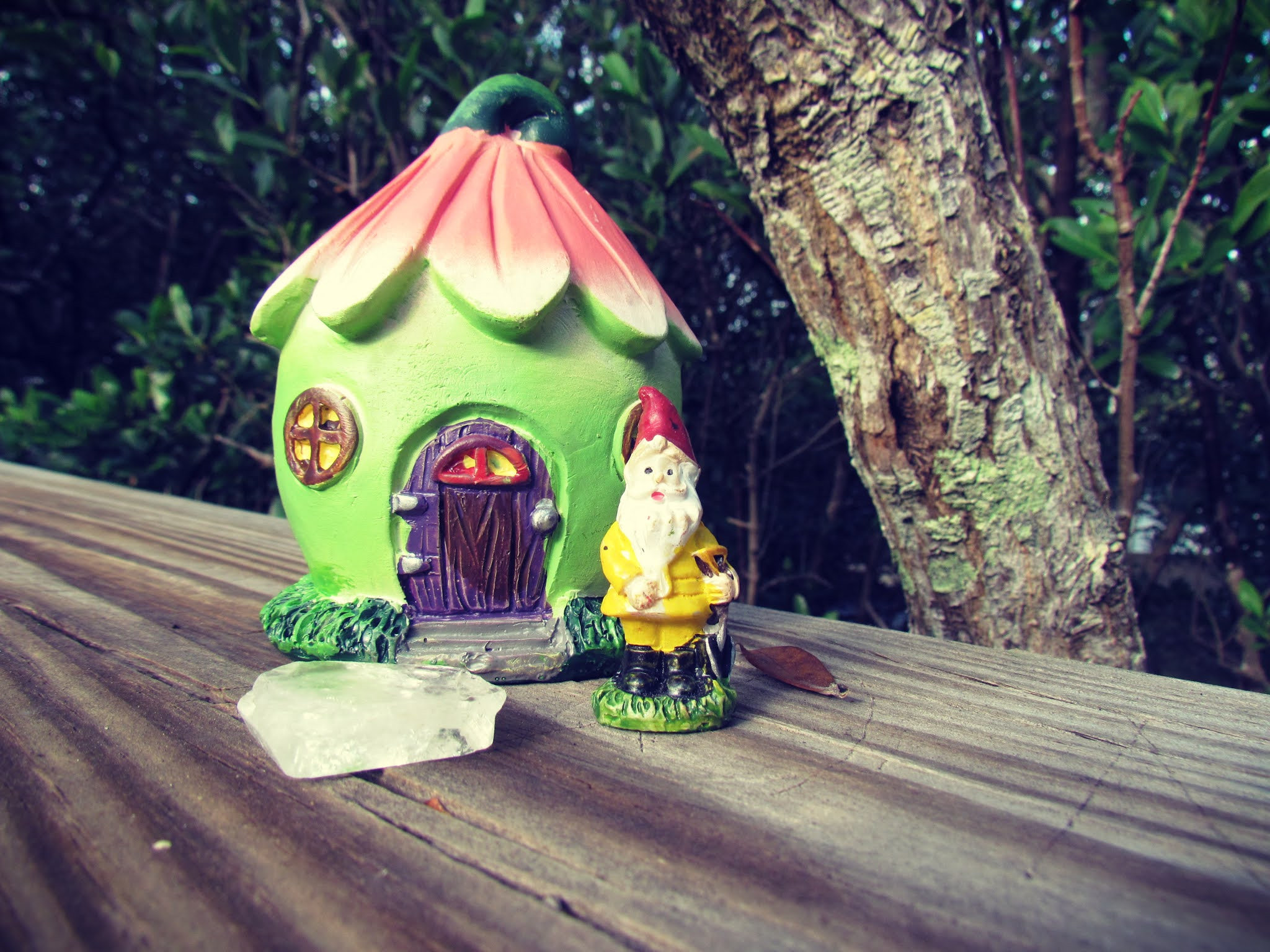 a gnome house, a fairy house, green cottage in the woods with pink trim, gnome figurine, apophyllite crystal energy, magical properties of the full moon, full moon mystic