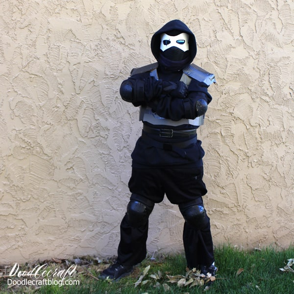 Make the perfect Halloween Fortnite Cosplay. The Enforcer Skin Costume DIY is easy to make with items found in the closet, upcycled items like cardboard, foam and brads and a boogie bomb.