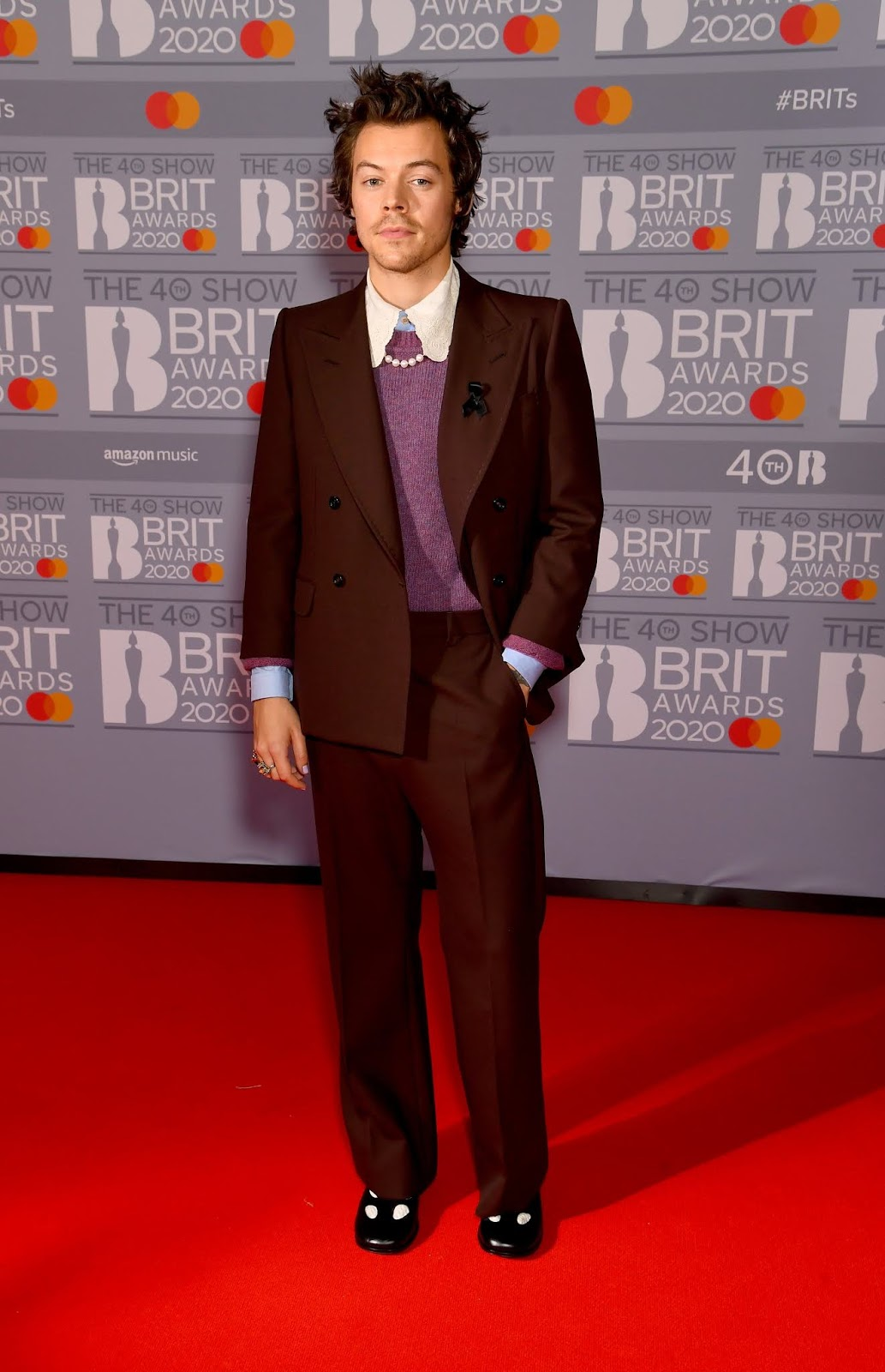 Harry Styles arrives at BRIT Awards wearing black ribbon after Caroline Flack's tragic death