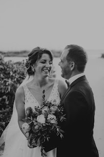 Photography of bride and groom laughing before reception.