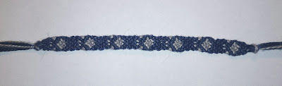 DIY friendship bracelet with button clasp in grey and royal blue